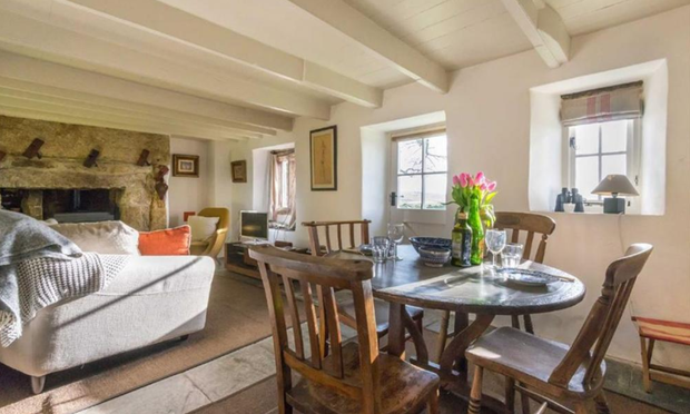 The property has a kitchen with exposed timbers, granite features. Photo: Stags