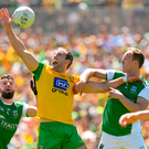 24 June 2018; Michael Murphy of Donegal is tackled by James McMahon, left, and Che Cullen of Fermanagh during the Ulster GAA Football Senior Championship Final match between Donegal and Fermanagh at St Tiernach's Park in Clones, Monaghan. Photo by Ramsey Cardy/Sportsfile