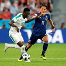 Japan vs Senegal - Ekaterinburg Arena, Yekaterinburg, Russia - June 24, 2018 Senegal's Ismaila Sarr in action with Japan's Takashi Usami
