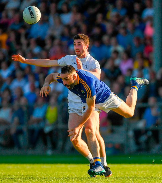 Longford's Diarmuid Masterson loses his footing as he is challenged by Kevin Flynn at Glennon Brothers Pearse Park. Photo by Piaras Ó Mídheach/Sportsfile