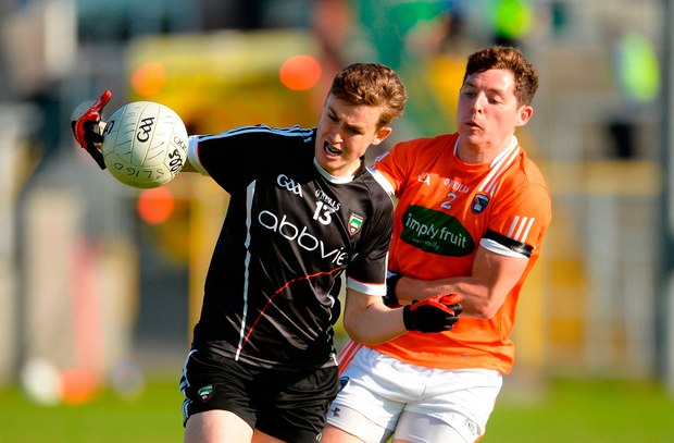 Kyle Cawley of Sligo in action against Patrick Burns of Armagh. Photo by Oliver McVeigh/Sportsfile