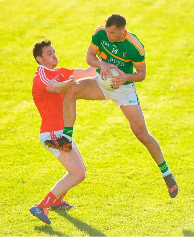Donal Wrynn of Leitrim in action against Tommy Durnin of Louth. Photo by Ramsey Cardy/Sportsfile