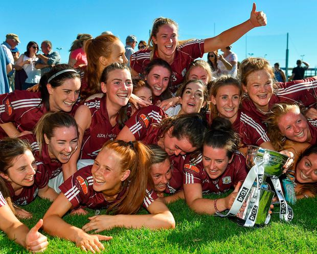 Galway players celebrate with the trophy after their victory over Mayo in the Connacht Ladies Senior Football final. Photo: Seb Daly/Sportsfile