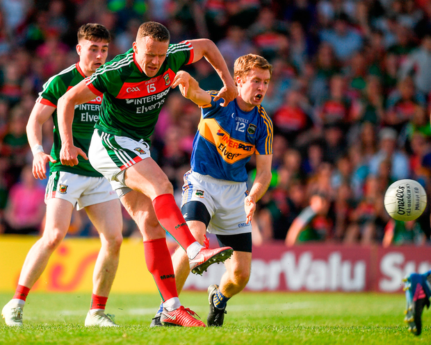Andy Moran fires a shot on goal despite the attention of Tipperary's Brian Fox. Photo by Ray McManus/Sportsfile