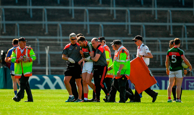 Seamus O'Shea is helped from the field after suffering an arm injury. Photo by Ray McManus/Sportsfile
