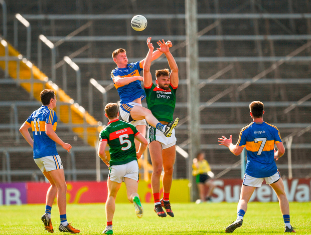 John Meagher of Tipperary and Aidan O'Shea of Mayo jump highest in an effort to win possession. Photo by Ray McManus/Sportsfile
