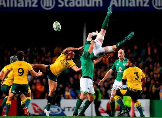 Peter O'Mahony is tackled in the air by Israel Folau, who has been cited for the incident. Photo: Brendan Moran/Sportsfile