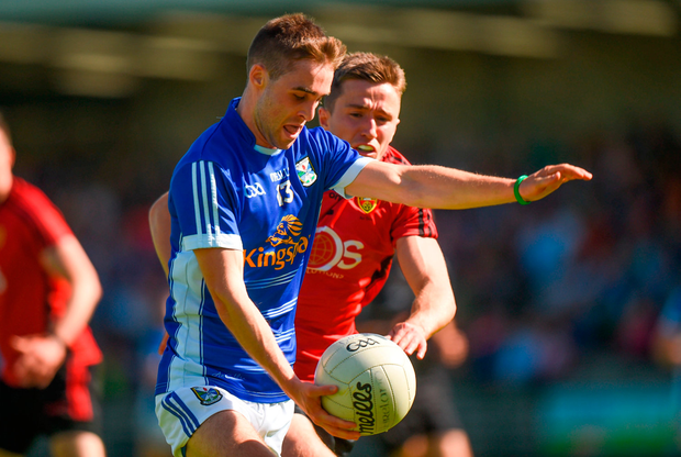Conor Bradley of Cavan in action against Ryan McAleenan of Down. Photo by Barry Cregg/Sportsfile