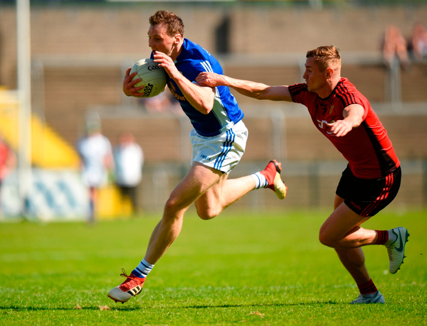 Gearoid McKiernan of Cavan in action against Caolan Mooney of Down. Photo by Barry Cregg/Sportsfile
