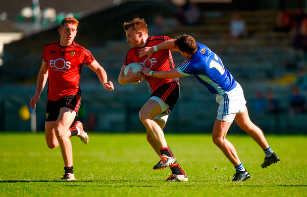 Brendan McArdle, centre, and Sean Dornan of Down in action against Niall Murray of Cavan. Photo by Barry Cregg/Sportsfile