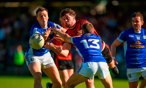 Niall Madine of Down in action against Niall Murray, left, and Conor Bradley of Cavan. Photo by Barry Cregg/Sportsfile
