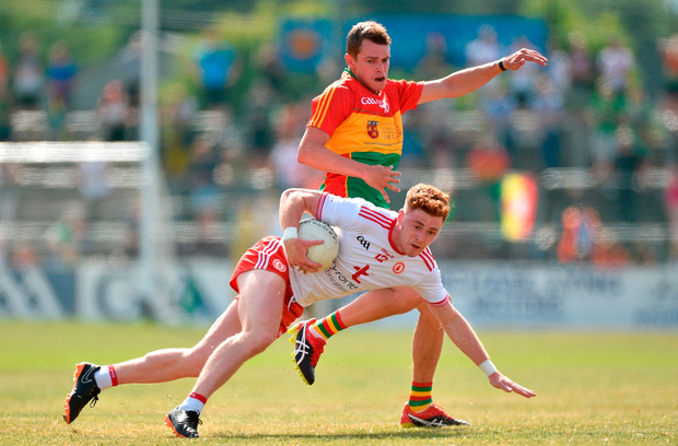 Conor Meyler of Tyrone in action against Sean Gannon of Carlow. Photo by Matt Browne/Sportsfile