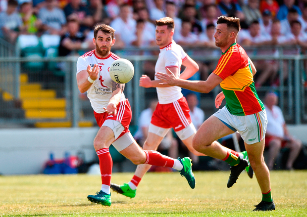 Ronan McNamee of Tyrone in action against Eoghan Ruth of Carlow. Photo by Matt Browne/Sportsfile
