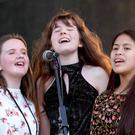 Taking part in Cruinniú na nÓg were (left to right) members of Kylemore College Glee Club, Ashleigh Kiernan, Chantelle Holland and Sinead Paraiso. Photo: Mark Stedman