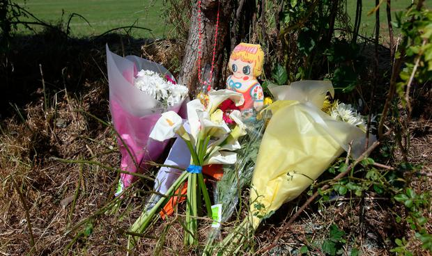 Flowers at the scene of Butler Park (Jobstown Park) in Tallaght, where the body of Adam Muldoon was discovered on Saturday morning. Photo: Gareth Chaney, Collins