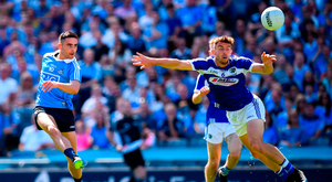 Dynamo: Dublin's Niall Scully gets his pass in as Laois' Colm Begley closes in during yesterday's Leinster decider