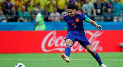 Falcao scores Colombia's second goal in their victory against Poland. Photo: Toru Hanai/Reuters