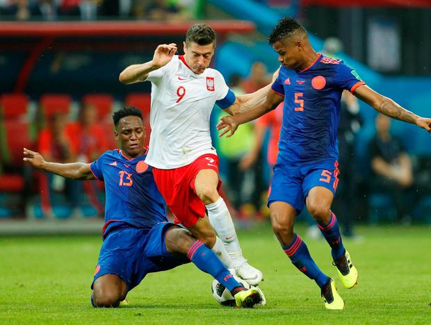 Poland's Robert Lewandowski in action with Colombia's Yerry Mina and Wilmar Barrios. Photo: John Sibley/Reuters