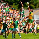Michael Murphy and Eoin Donnelly battle to win possession. Photo by Oliver McVeigh/Sportsfile