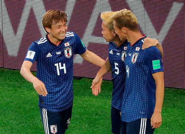 Japan's Keisuke Honda celebrates with Takashi Inui and Yuto Nagatomo after scoring their second goal. Photo: Marcos Brindicci/Reuters