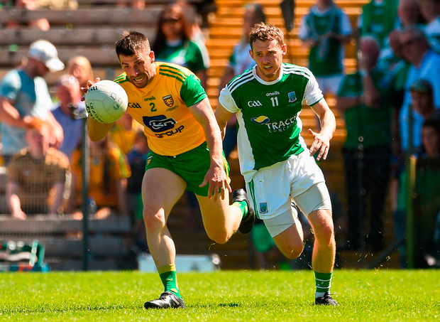 Paddy McGrath of Donegal in action against Declan McCusker of Fermanagh. Photo by Oliver McVeigh/Sportsfile