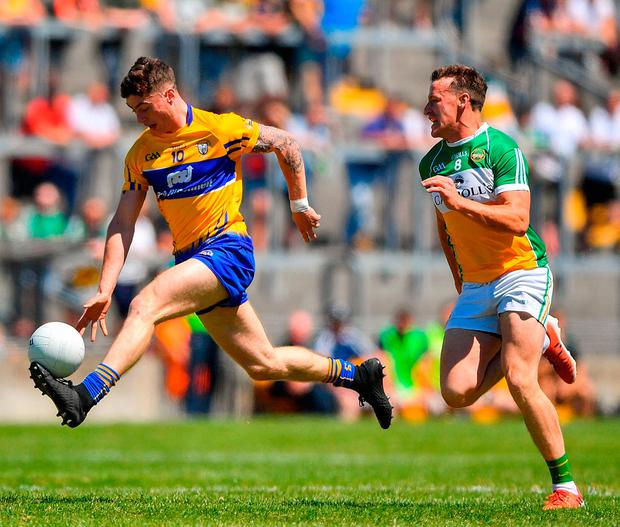 Clare's Ciarán Malone gets away from Michael Brazil during the football qualifier Bord Na Mona O'Connor Park. Photo by Harry Murphy/Sportsfile