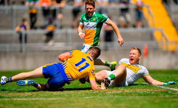 Eoin Cleary of Clare in action against Alan Mulhall of Offaly. Photo by Harry Murphy/Sportsfile