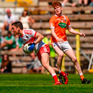 Conor McCluskey of Derry in action against Conor Turbitt of Armagh. Photo by Philip Fitzpatrick/Sportsfile