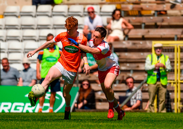 Conor Turbitt of Armagh in action against Conor McCluskey of Derry. Photo by Philip Fitzpatrick/Sportsfile