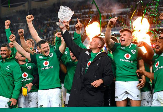 Peter O'Mahony holds aloft the trophy as he celebrates with teammates after winning the series. Photo: David Moir/Reuters