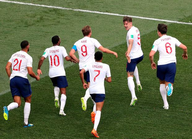 England's John Stones celebrates scoring their fourth goal with team mates. Photo: Ivan Alvarado/Reuters