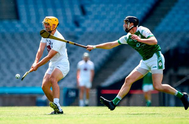 Kildare's Martin Fitzgerald in action against London's Oisín Gately. Photo: David Fitzgerald/Sportsfile