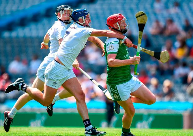 Colin Nelson of London in action against Mark Grace of Kildare. Photo: David Fitzgerald/Sportsfile