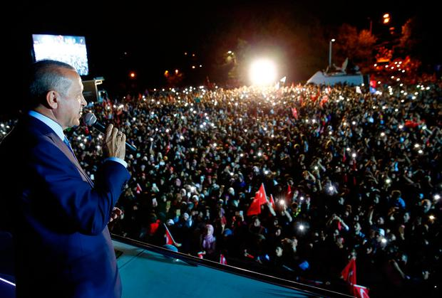 Turkey's President and leader of ruling Justice and Development Party Recep Tayyip Erdogan addresses his supporters from his Tarabya Palace in Istanbul, late Sunday, June 24, 2018. Erdogan has claimed victory in critical elections based on unofficial results, securing an executive presidency with sweeping powers. (Presidential Press Service via AP, Pool)