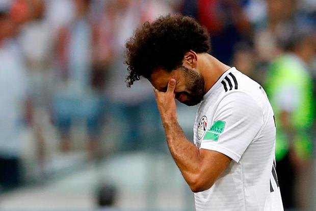 Soccer Football - World Cup - Group A - Saudi Arabia vs Egypt - Volgograd Arena, Volgograd, Russia - June 25, 2018 Egypt's Mohamed Salah looks dejected after the match REUTERS/Darren Staples