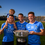 Dublin players, from left, Darren Daly, with his son Odhrán, age 2, Jonny Cooper and Paul Flynn following the Leinster GAA Football Senior Championship Final match between Dublin and Laois at Croke Park in Dublin.