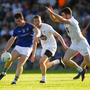 Liam Connerton of Longford shoots under pressure from James Murray and Kevin Flynn, right, of Kildare during the GAA Football All-Ireland Senior Championship Round 2 match between Longford and Kildare at Glennon Brothers Pearse Park in Longford.