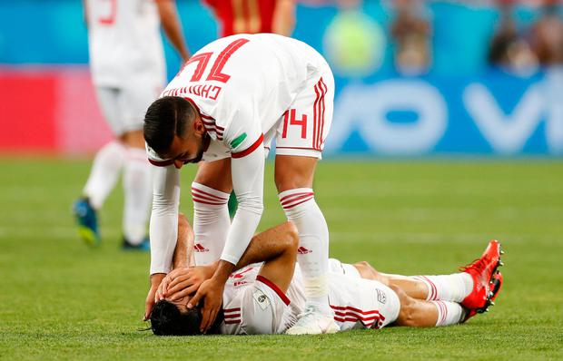 Soccer Football - World Cup - Group B - Iran vs Portugal - Mordovia Arena, Saransk, Russia - June 25, 2018 Iran's Mehdi Taremi and team mates are dejected after the match REUTERS/Matthew Childs