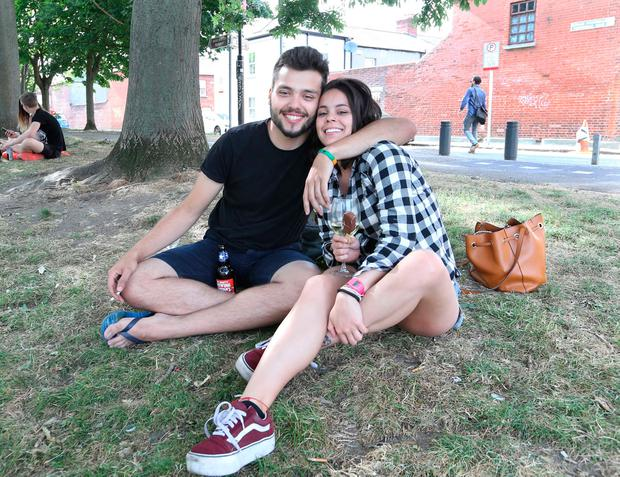 Pictured are Heloisa Belarmino and Luiz Rodrigo Pereira enjoying the sunshine and hot weather along Dublin's canals: RollingNews.ie