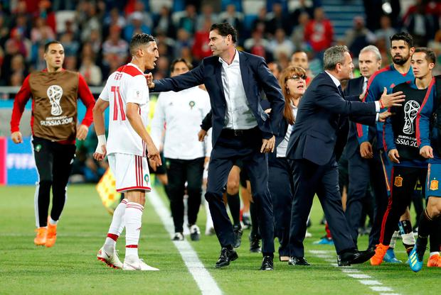 Spain coach Fernando Hierro and Morocco's Faycal Fajr as tempers flair near the end of the match. Photo: REUTERS/Gonzalo Fuentes