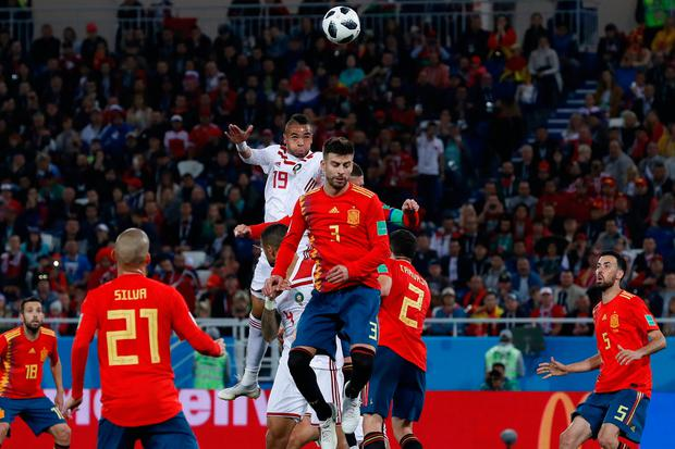 Morocco's Youssef En Nesyri, top, jumps to score his side's second goal. AP Photo/Manu Fernandez