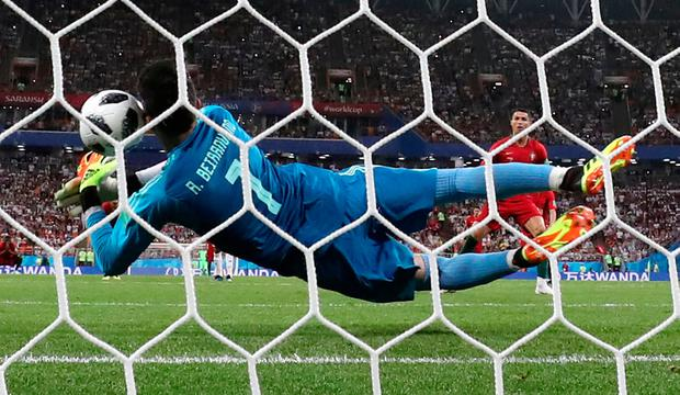 Iran's Alireza Beiranvand saves Cristiano Ronaldo's penalty. Photo: REUTERS/Murad Sezer