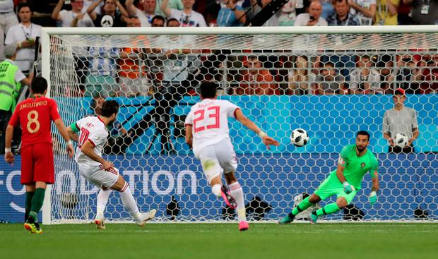 Karim Ansarifard equalises for Iran from the penalty spot. Photo: REUTERS/Ivan Alvarado