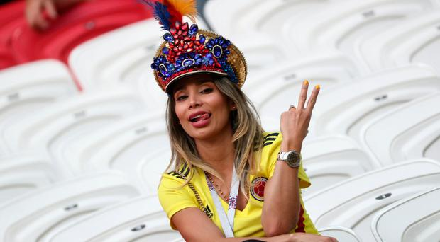 Colombia fan inside the stadium before the match REUTERS/Sergio Perez
