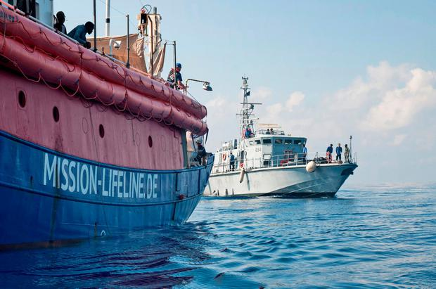 In this photo taken on Thursday, June 21, 2018, the ship operated by the German NGO Mission Lifeline is reached by a Libyan Coast Guard boat after they rescued migrants from a rubber boat in the Mediterranean Sea in front of the Libyan coast. (Hermine Poschmann/Mission Lifeline via AP)