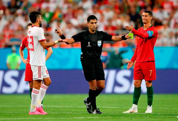 'It is true that the Paraguayan referee Enrique Caceres lost control of proceedings in the dying stages of Iran's dramatic clash with Portugal on Tuesday.' Photo: Getty Images