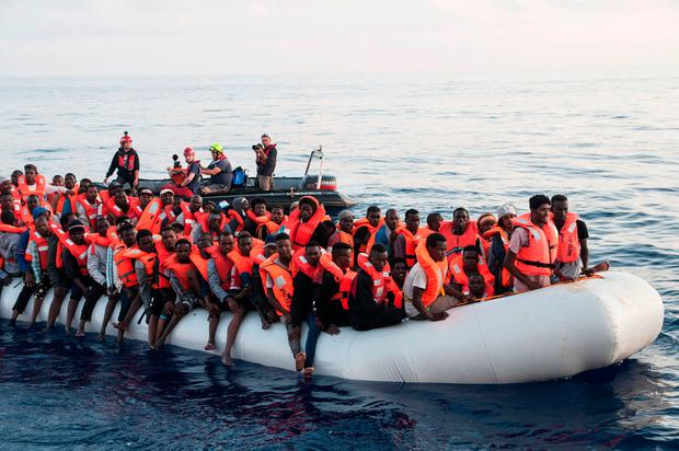 Some of the 230 migrants rescued by a Lifeline ship