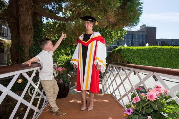 Vicky Phelan, who was awarded an honorary degree at University of Limerick is congratulated by her son Darragh. Photo: Mark Condren