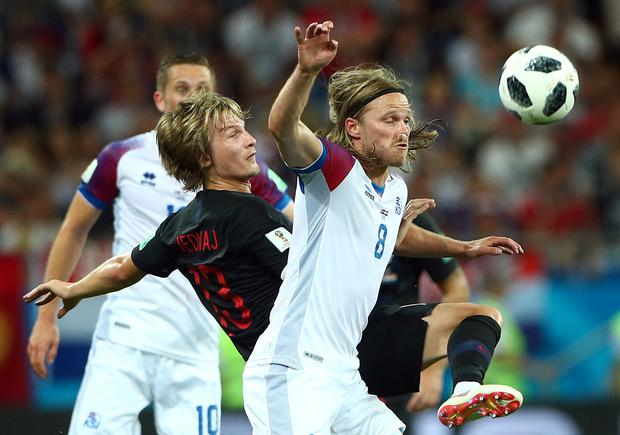 Croatia's Tin Jedvaj in action with Iceland's Hordur Magnusson. Photo: Reuters
