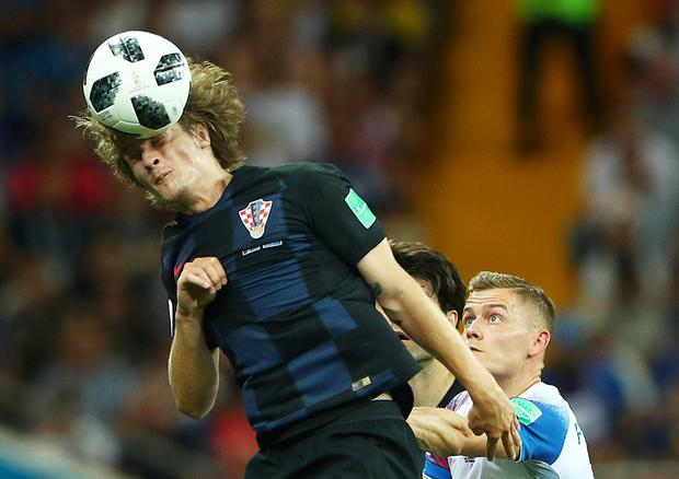Croatia's Tin Jedvaj rises above Iceland's Alfred Finnbogason. Photo: Reuters